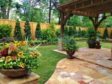 Houzz spring landscaping trends study garden design for Small fenced in patio ideas