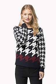Stand out in style with this sophisticated houndstooth jumper. Large houndstooth pattern throughout, contrasting pattern colour along the bottom hem with unicoloured collar, cuffs and bottom hem. Tommy Hilfiger logo tag on the sleeve.<br/><br/>Our model is 1.76m and is wearing a size S Tommy Hilfiger jumper.