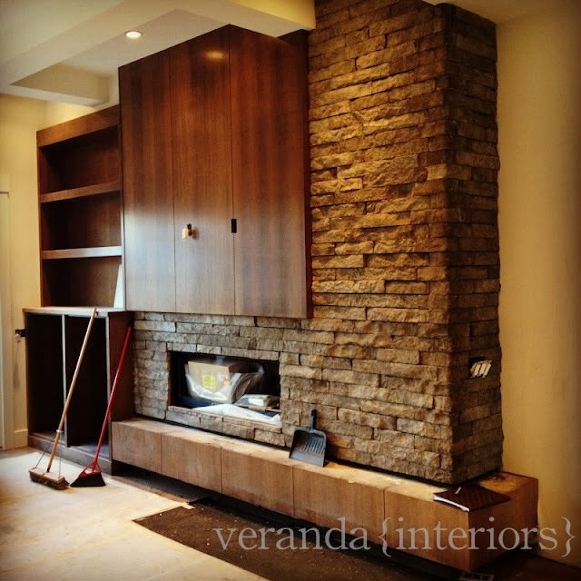 Stone fireplace and accent wall with wood hearth you for Stone fireplace wall