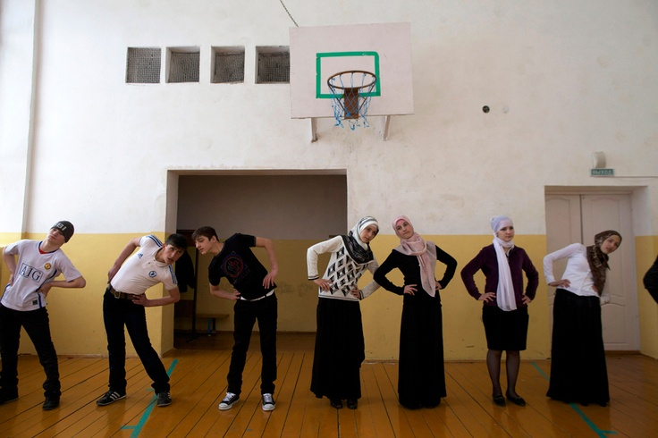 Gym class at School No. 1 in the Chechen village of Serzhen-Yurt. The schoolgirls, all dressed in skirts with their heads wrapped in scarves, say gym clothes violate the Muslim dress code