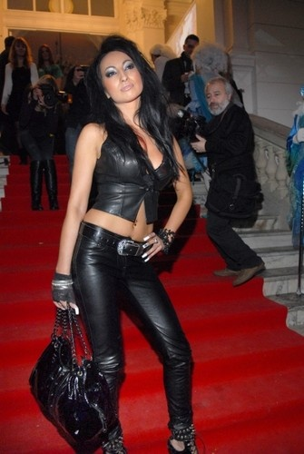 Jola Rutowicz in a leather outfit.