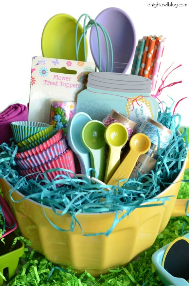 This basket is for your inner pastry chef! Give the gift of cupcake wrappers, measuring spoons, whisks, and more in a colorful bundt pan.