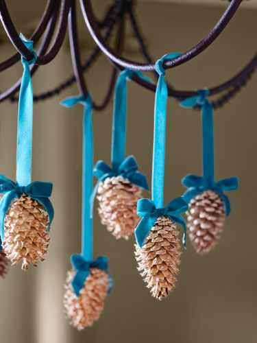 Hang these lighter, brighter pine cone ornaments from your chandelier with colorful velvet ribbon.