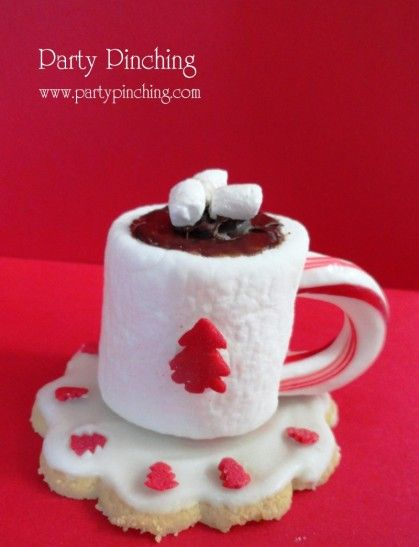 Hot Cocoa Marshmallow Cookie- TONS of cute party dessert items at this site! This is a cookie, a marshmallow, candy cane, tree sprinkle, chocolate frosting and vanilla mallow bits on top!