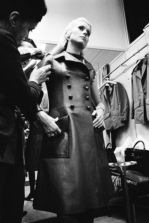 Catherine Deneuve fitted at Yves Saint Laurent, c1966. Looks like a coat worn in Belle du Jour; YSL designed Miss Deneuve's wardrobe.