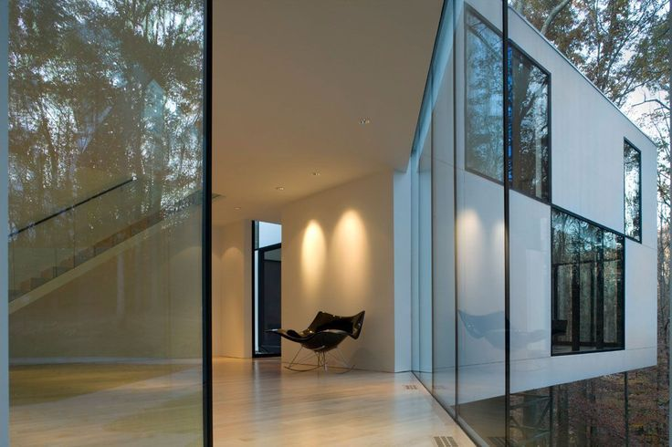 Stingray rocking chair stealing the show in this pure hallway.