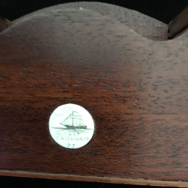 makers mark for Robert Callahan - bone disk engraved with drawing of clipper ship, name Robert Callahan and year found inset in furniture
