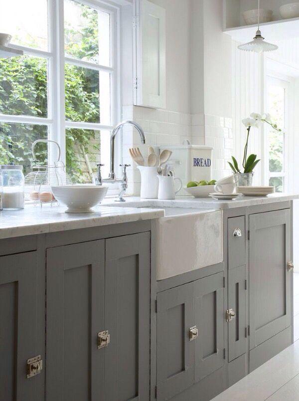 dark barnwood floors, farmhouse sink, white upper cabinets & dark lower cabinets!