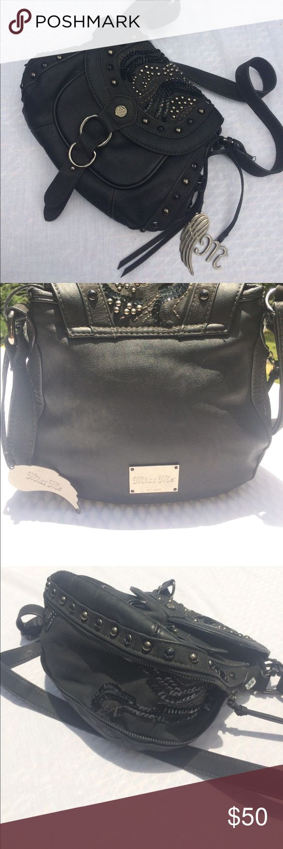 Embellished Black Miss Me Purse Soft black leather purse embellished with silver and black studs, rhinestones, and sequins throughout. The zipper running along the sides and bottom of the purse opens to reveal additional space and a beautiful sequin design. Leather straps are adjustable for custom fit. Inside of the purse has an open pocket and zipper pocket. Gently used. Miss Me Bags Crossbody Bags