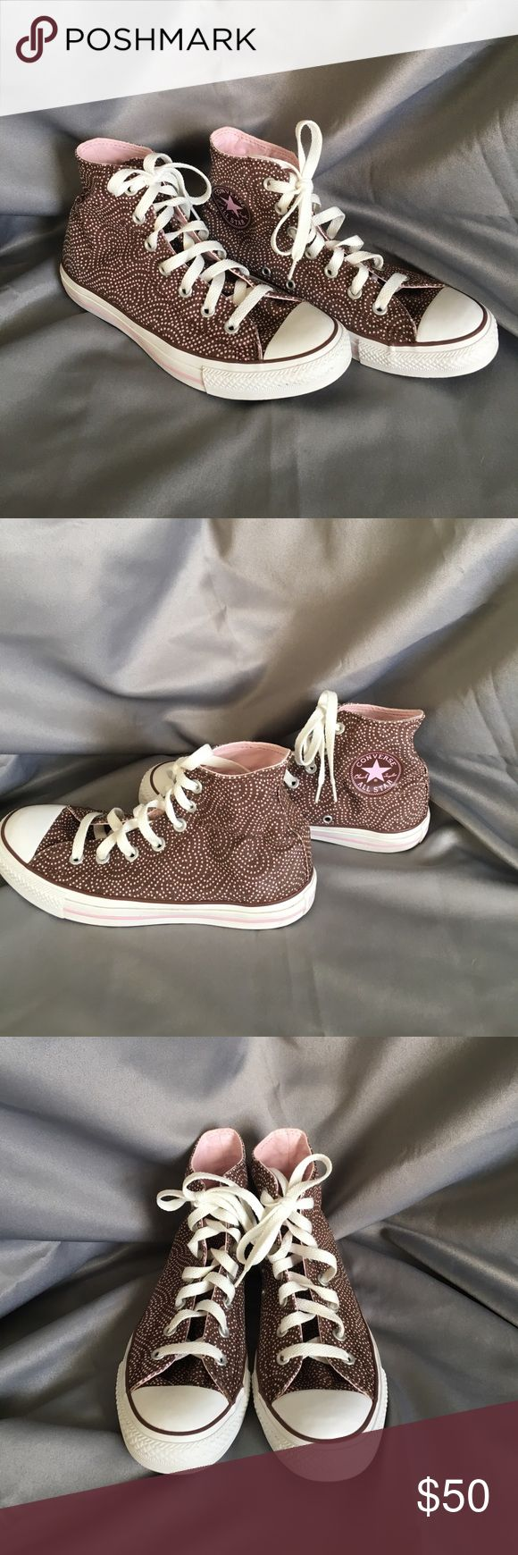 Converse Hightops Brown w/Pink 💕 Swirl Polka Dots Converse Hightops Brown w/Pink Heart Swirl Polka Dots. Gently used. Size is a men's 6 or women's 8. Sticker marks on the inside soles. See pic. Converse Shoes Sneakers