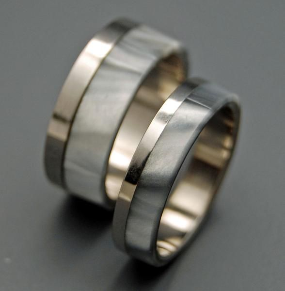 Titanium Rings - Unique Wedding Rings. Stunning on, but simple and unique. Edged by a highly buffed and polished band of titanium, this ring is offset with a sm