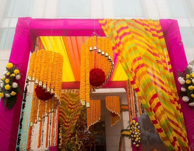 Such beautiful pink and yellow Decor with marigold and red roses.... stunning impeccable