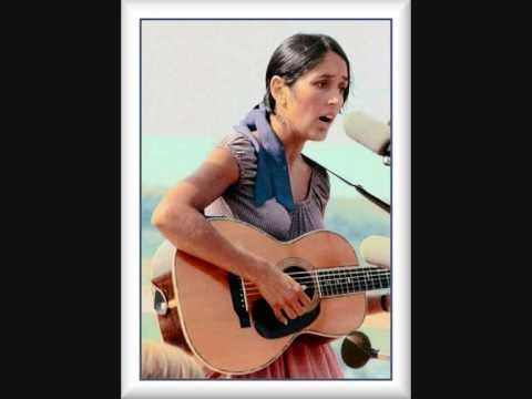 Joan Baez  - Blowin' in the wind... if you were brought up by a flower child , you've heard of Joan & this song!
