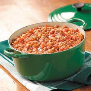 Stuffed Pepper Soup - •1 package (8.8 ounces) ready-to-serve long grain and wild rice  •1 pound ground beef  •2 cups frozen chopped green peppers, thawed  •1 cup chopped onion  •1 jar (26 ounces) chunky tomato pasta sauce  •1 can (14-1/2 ounces) Italian diced tomatoes, undrained  •1 can (14 ounces) beef broth