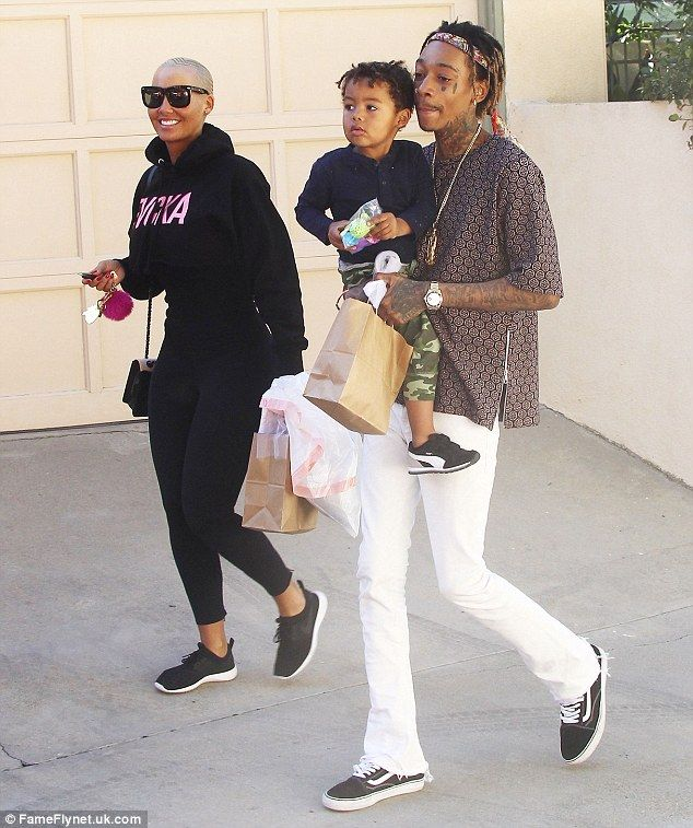 Getting along nicely: Amber Rose looked to be in good spirits as she and estranged husband Wiz Khalifa took their son Sebastian to the playground in Los Angeles on Wednesday