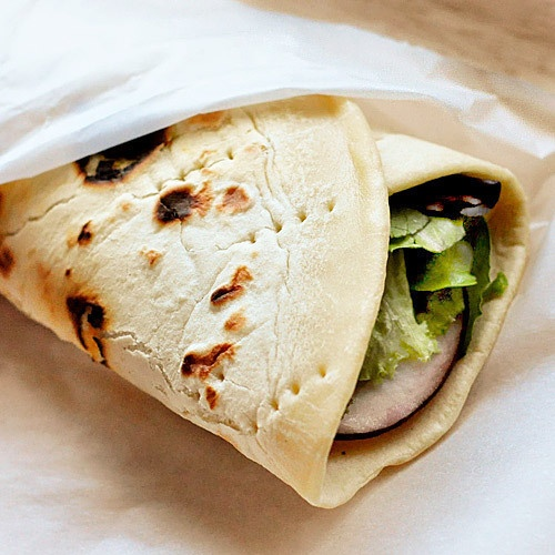Homemade Piadinas  Makes 6 large or 8 small piadinas  4 1/2 cups (23 oz) all-purpose flour  1 tablespoon baking powder  1.5 teaspoons kosher salt  1/3 cup (2 oz) lard or vegetable shortening  1 1/2 cups (12 oz) water