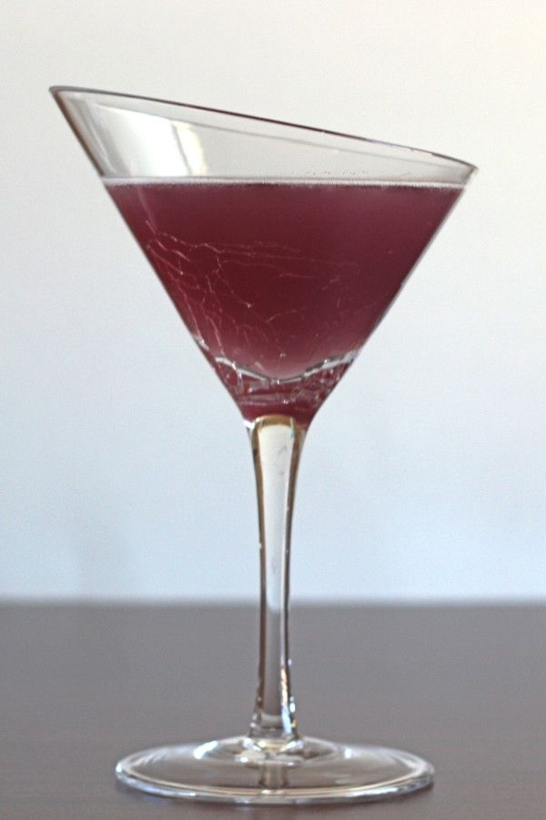 Purple Turtle Cocktail drink recipe with coconut rum, triple sec, cranberry juice and blue curacao.