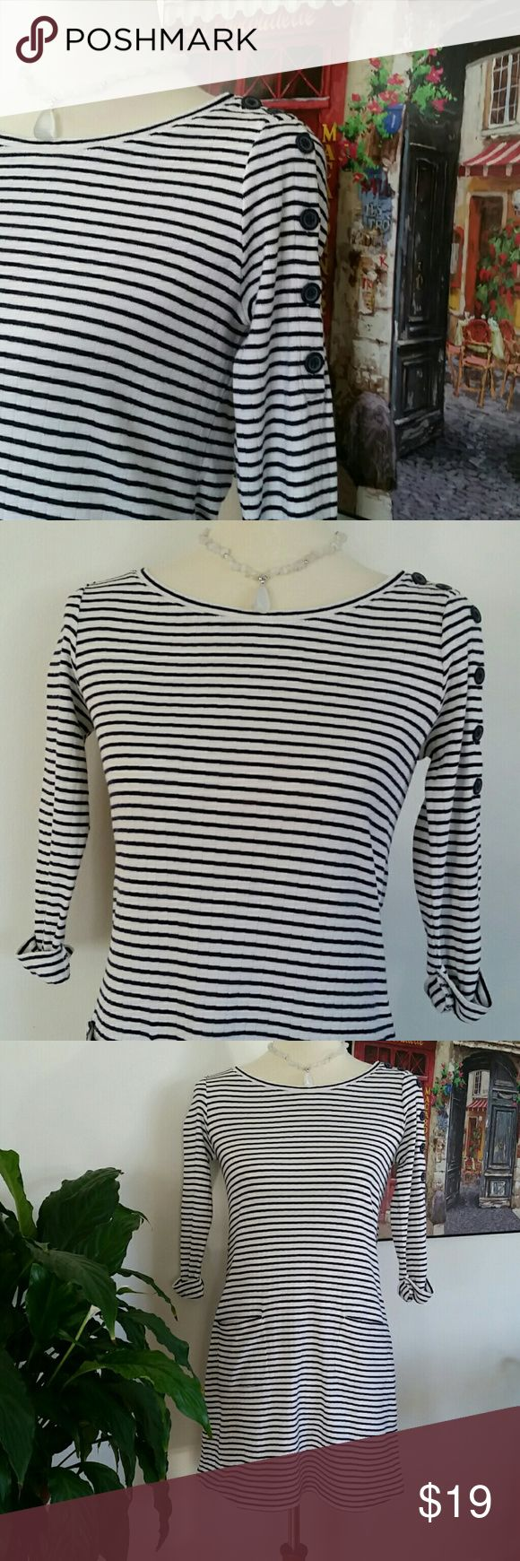 Cute GAP Dress Simple and comfy adorable navy & white colored striped dress. 3/4 length sleeves, two front pockets with one sleeve accented with decorative buttons. Perfect for weekend wear or a casual day out. 100% Cotton, Size XS. Good condition. GAP Dresses