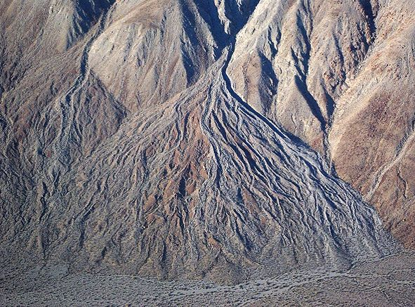 """98 Likes, 2 Comments - American Geographical Society (@americangeographicalsociety) on Instagram: """"Landform of Day #16: Alluvial fan, Death Valley, CA. When a mountain stream carries a lot of…"""""""