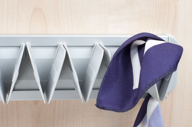 Hang ties, scarves, belts and more tidily with the Ambos fixed tie hanger in silver anodized aluminium finish. Fix inside wardrobe, on doors or walls for convenient hanging. Fibreglass-reinforced nylon clips.