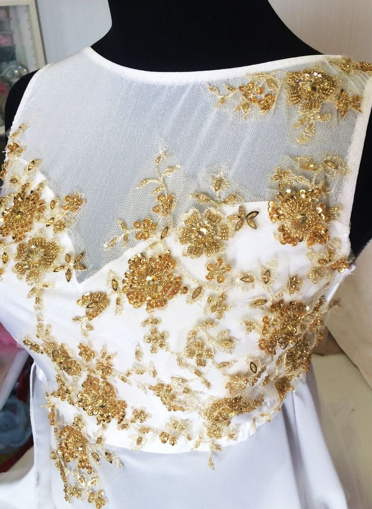 white with delicate gold lacework.by jennifer Cowie