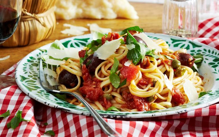 With a rich and salty sauce of anchovies, olives, tomatoes and capers, this spaghetti dish has all the hallmarks of southern italian cuisine.