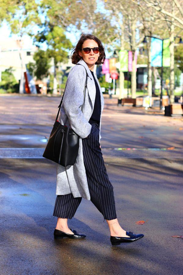 Chloe Finley, Junior Fashion Editor Cos top, Lonely Hearts coat, Bassike pants, Lanvin shoes, Georg Jensen watch, Mansur Gavriel bag, Sunday Somewhere sunglasses.