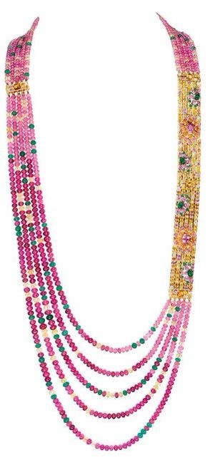 Boucheron Isola Bella necklace with rubellite and tourmaline beads, yellow sapphires, emeralds and spessartite garnets, rubies, pink sapphires and diamonds in yellow gold. The two gold sections can be detached to form a bracelet and the necklace can be worn shorter