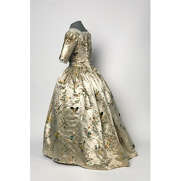 ca 1760  For a girl: back-fastening with a trained skirt; made of ivory silk hand embroidered with motifs of birds, butterflies, etc in coloured silks; woven and embroidered in China, sewn in England  Miss L Band gift