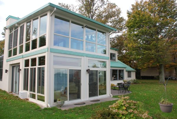 An Amazing Story Of A Two Story Sunroom Built On Lake Erie Built With Access To Both Floors And A Spiral S House Extension Design Sunroom Designs Patio Stones