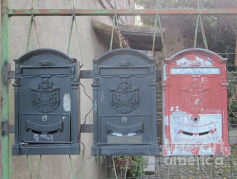 Caselle di posta by Nancy Worrell -- Caselle di posta -- old mailboxes on a fence along Via Appia, Rome. #mailbox #letter, #post #rome #worrell #nancy