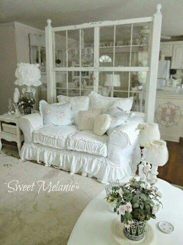 white sofa white doors as room divider