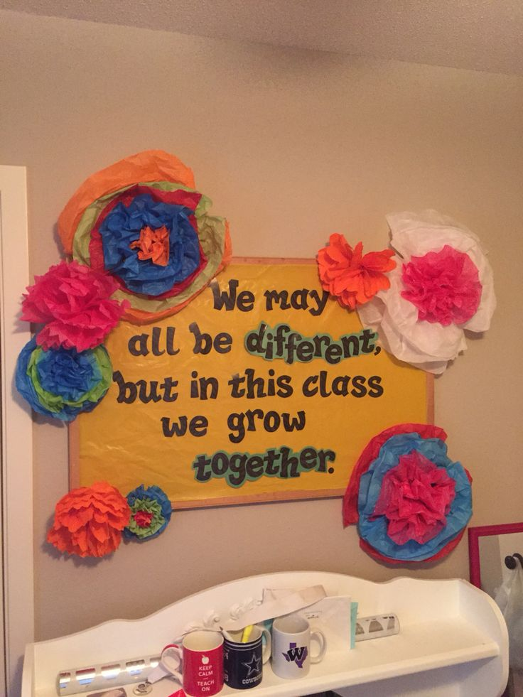 Mexican paper flower bulletin board for my third grade bilingual class. We may all be different, but in this class we grow together.