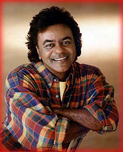 """Johnny Mathis -John Royce """"Johnny"""" Mathis is an American singer of popular music. Starting his career with singles of standard music, he became highly popular as an album artist.  Gilmer, TX"""