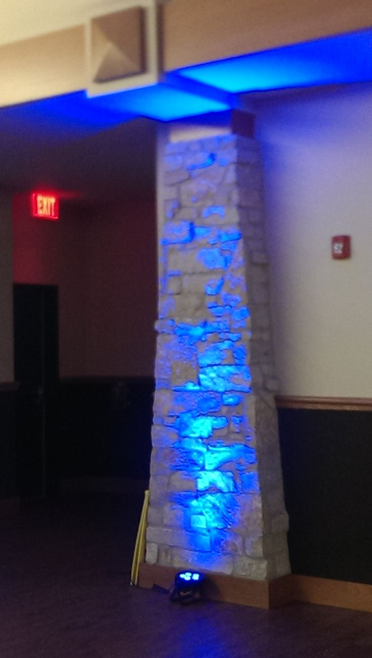 blue spotlights on the stone pillars in Knox Center