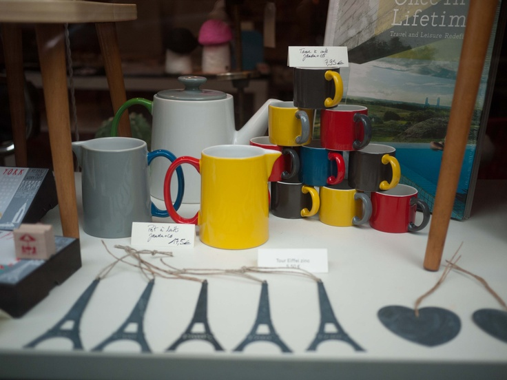 The colorful collection of mugs, tea pots and jars from Jansen+Co. Seen from the Rocketship window (my little parisian deco and coffee shop)