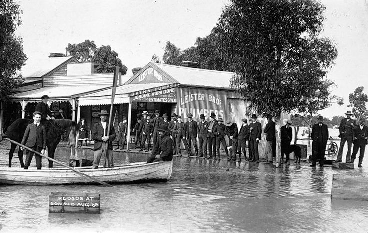 Inspecting floodwaters in Donald, outside Leister Brothers, plumbers, in August 1909.