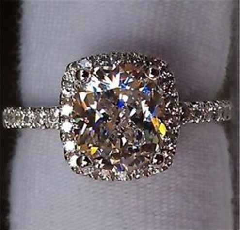 Cushion cut diamond with halo setting and diamond band! LOVE this! Perfection! I just need some pink.