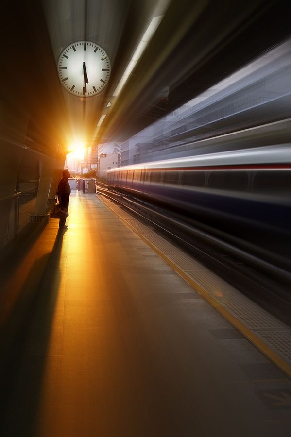 Moving train, sun shining onto a train station...all on a slow shutter speed. Beautiful