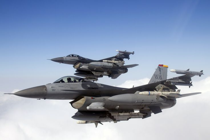 Two U.S. Air Force F-16 Fighting Falcons from the 35th Fighter Wing conduct Suppression of Enemy Air Defense training over Misawa Air Base, Japan, Feb. 14, 2013. The SEAD mission is also referred to as the mission of the Wild Weasels, and has been active at Misawa Air Base for nearly 20 years. Every Wild Weasel pilot is required to pass a verification process that allows them to fly in combat missions of the 35 FW. (Photo by Jake Melampy)
