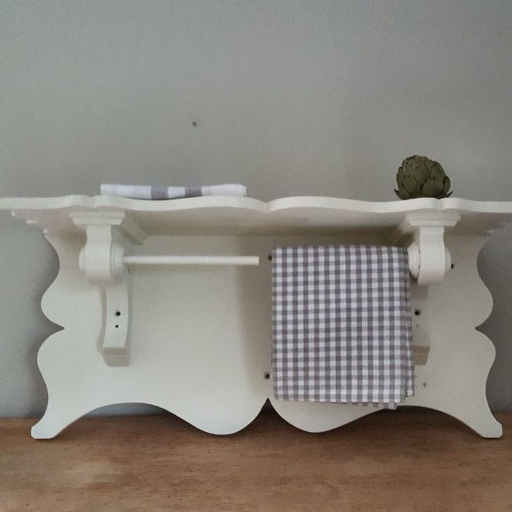 Beautiful turned wood towel holder shelf for kitchen or guest towels. So Scandinavian country.