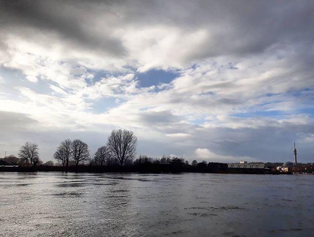 Dramatic skyline dark clouds blue sky breaking through high water... today in #Arnhem.