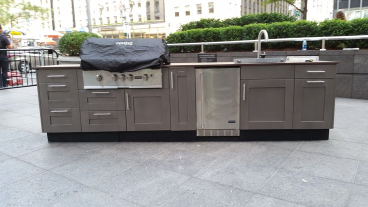 Cabinets: Brown Jordan Outdoor Kitchens With A Palm Beach Door Style In A  Versailles Powder Coated Finish Counter Top: Dekton Grill: Coyote