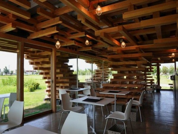 interior of Unique Cafe with Pile of Timber as Construction