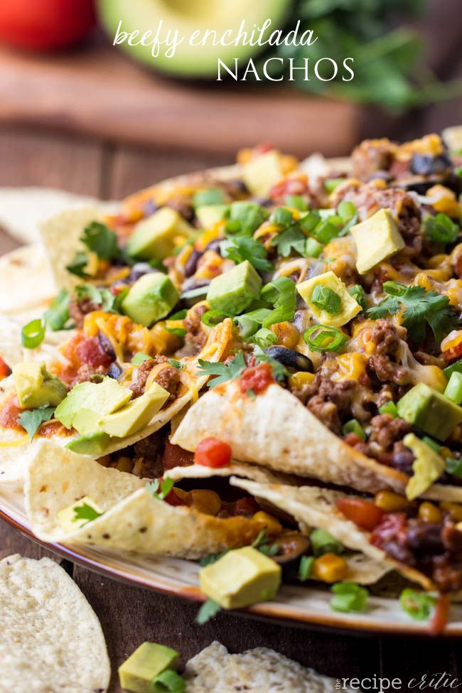 Beefy Enchilada Nachos that are loaded with all of the amazing things of an enchilada and are absolutely amazing!