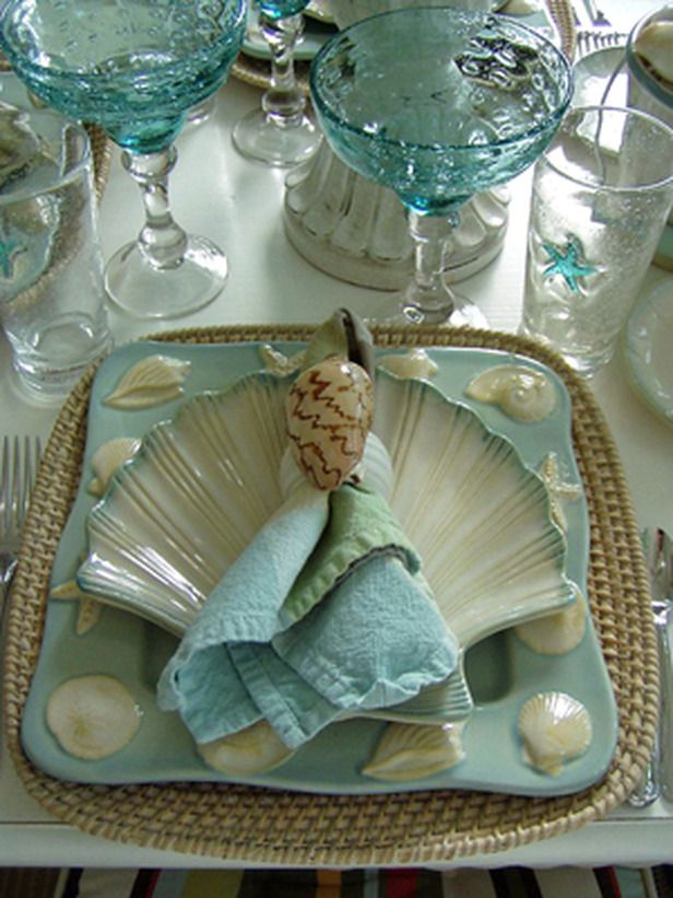 MoonlightandMagnolias customized each place setting by gluing a single found shell to a plain white napkin ring. A woven charger, majolica-style plates and linen napkins in watercolor hues create a charming whole.