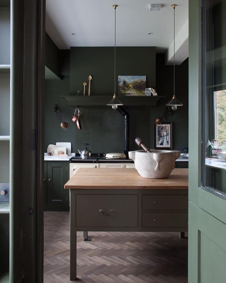 Love the moody green palette and herringbone floors
