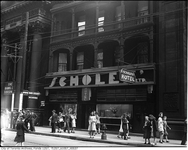 Pedestrians on the street and sidewalk in front of Scholes' Hotel, Toronto, c. 1945. #vintage #Canada #1940s #streets