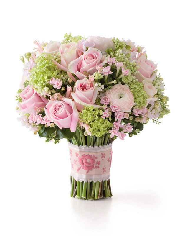 Ribbon-tied bouquet of bouvardia, lilacs, nerine, ranunculus and 'Rosita Vendela' roses