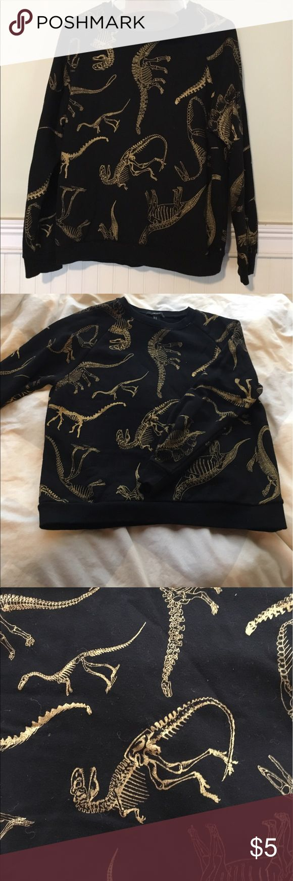 Forever 21 Black & Gold Dinosaur Sweatshirt This black and gold dinosaur sweatshirt from Forever 21 is so fun! It has been worn a few times, but is in great condition with no stains, fraying, etc. It is long sleeved, can be washed in the washer machine, and will be great for those fun late summer, fall nights. Ask any questions you may have! Forever 21 Tops Sweatshirts & Hoodies